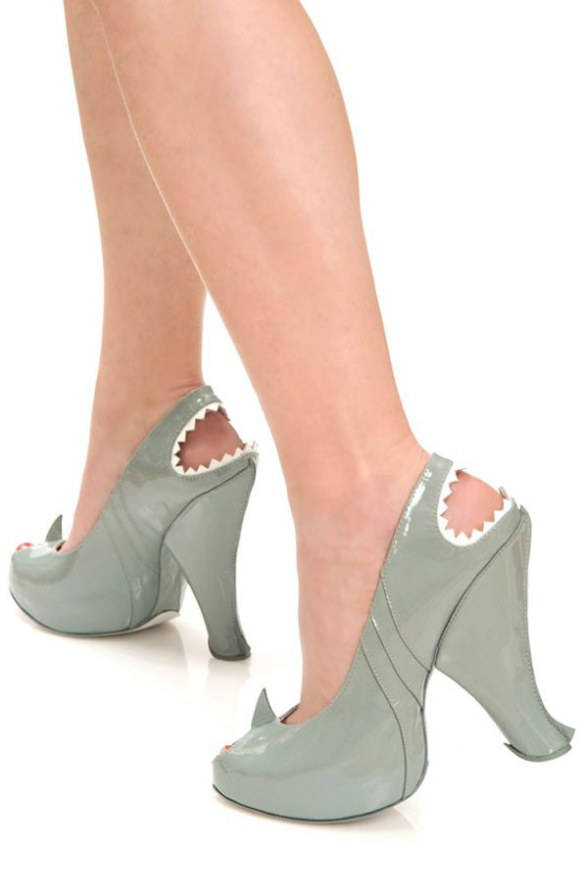 Sorry, I couldn't find any photos of guys in shark-high-heels.  ...not for lack of trying.